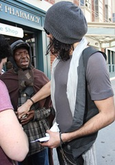 Russell Brand giving money